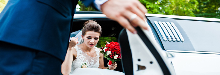 bride getting out of white limo