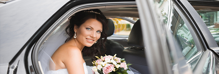 bride in a luxury wedding car