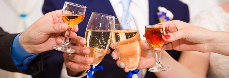 toasting glasses at a wedding