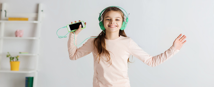 girl in headphones listening to music
